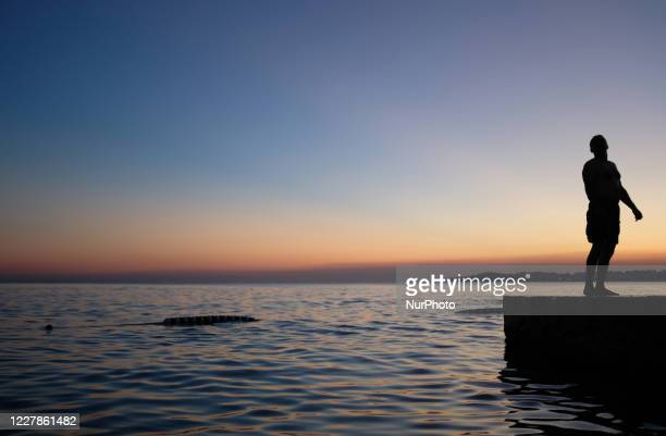 Man enjoys summer weather as he swimming at Gurpinar beach in Istanbul, Turkey on July 31, 2020.