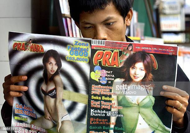A man enjoys to read Indonesian tabloid with scantily dressed women pictures on it in Jakarta 15 January 2006 Indonesian Muslim leaders on Friday...