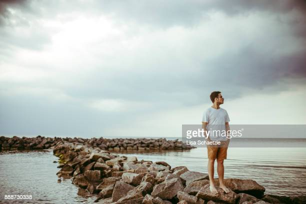 man enjoys view at sea