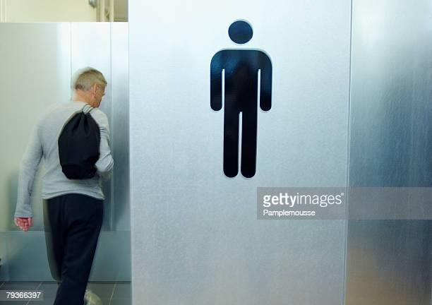 Man entering gym locker room