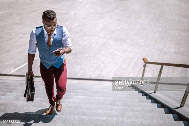man entering railroad station - moving up stock pictures, royalty-free photos & images