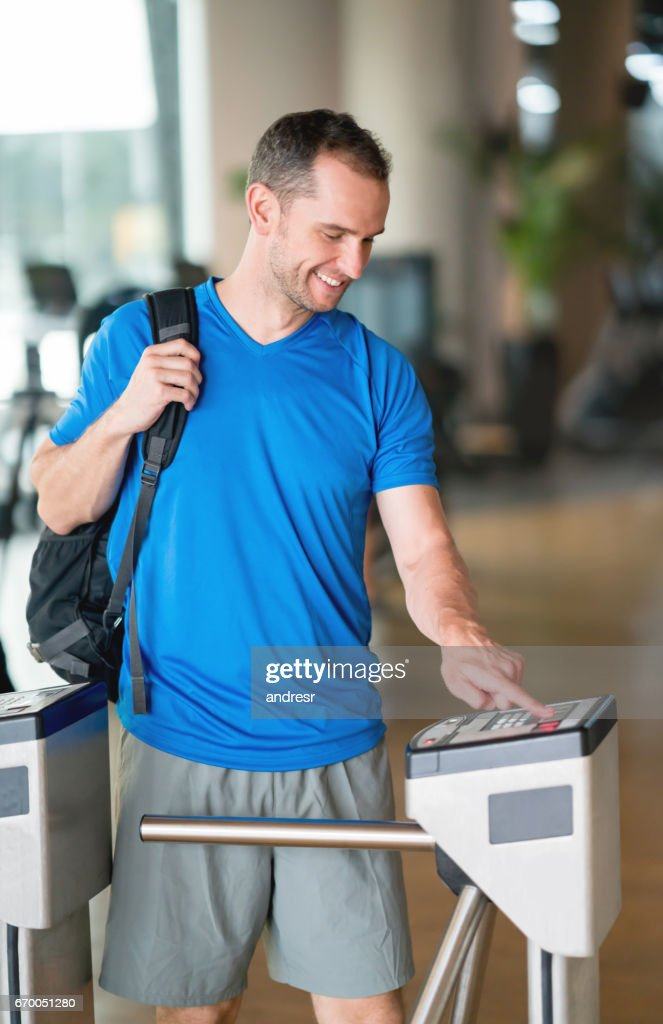 Man entering the gym with a fingerprint scan : Stock Photo