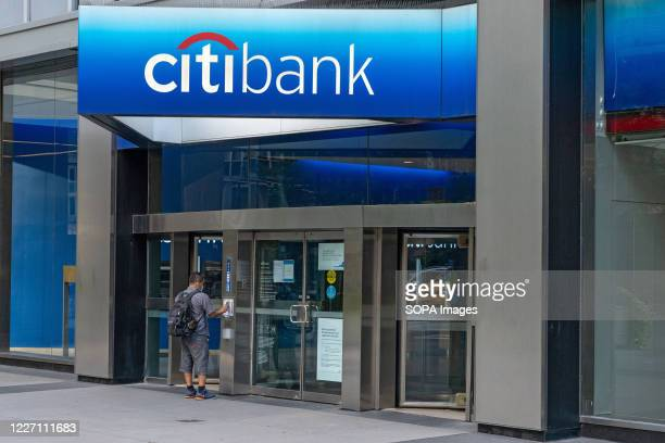 Man enters a Citibank branch of Citigroup in New York City. Profit plummeted at the bank because of COVID-19 pandemic. Citibank is expected to reveal...