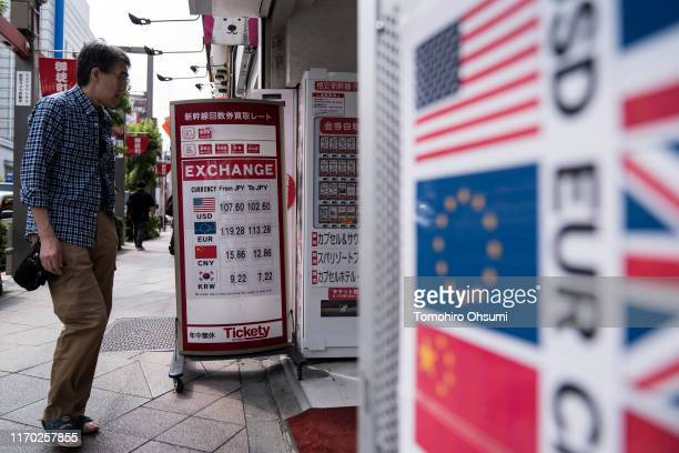 A man enters a currency exchange store on August 26 2019 in Tokyo Japan Japanese stocks dropped and the yen climbed against the US dollar after US...