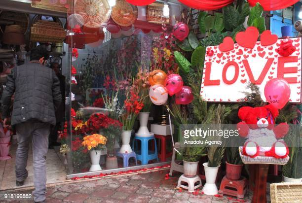 A man enters a decorated souvenir shop on Valentine's Day in Kabul Afghanistan on February 14 2018