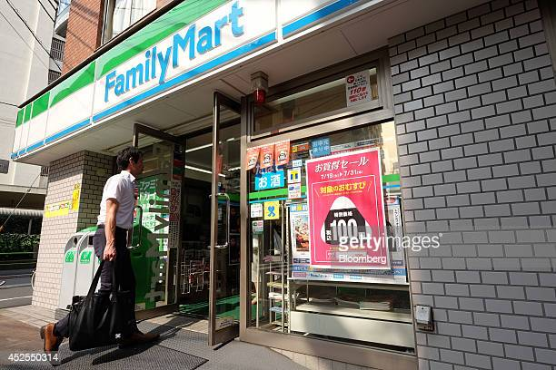 A man enters a FamilyMart Co convenience store in Tokyo Japan on Wednesday July 23 2014 Japan suspended food imports from Shanghai Husi Food Co a...