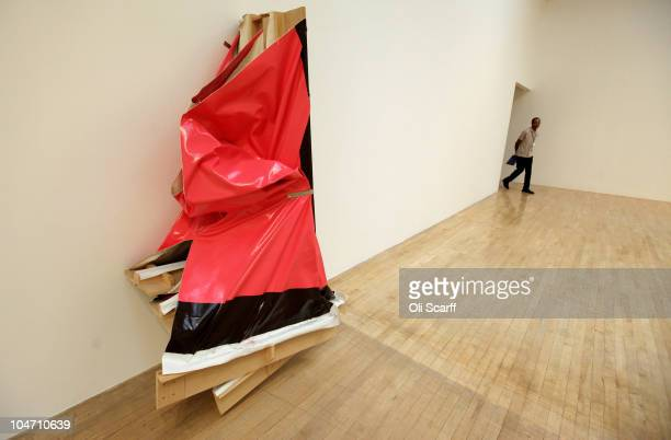 A man enters a gallery space displaying artwork by Angela de la Cruz entitled 'Super Clutter XXL ' which has been shortlisted for the Turner Prize...