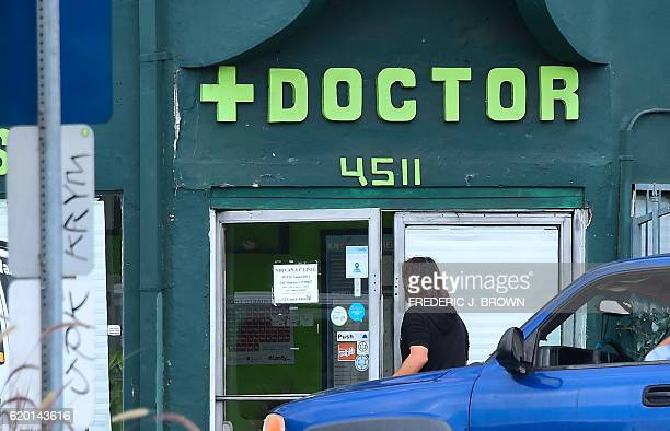 A man enters a medical marijuana dispensary in Hollywood California on November 1 2016 ahead of next week's general elections where California is the...