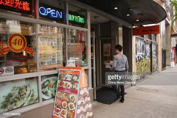 A man enters a restaurant at Chinatown on May 28 2020 in Vancouver Canada The Coronavirus pandemic has spread to many countries across the world...