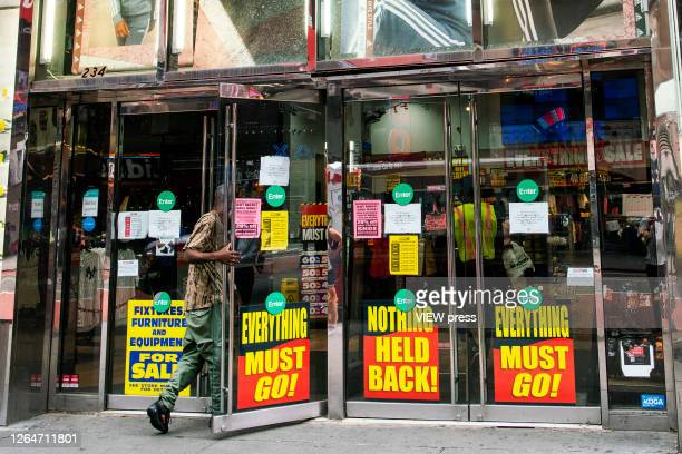 A man enters a retail store closing in Times Square on August 8 2020 in New York City With more than four months NYC has closed some of their doors...