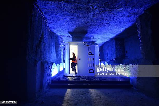 A man enters a room of cabling servers in an underground datacenter on November 15 2016 near Saumur western France The underground datacenter is...