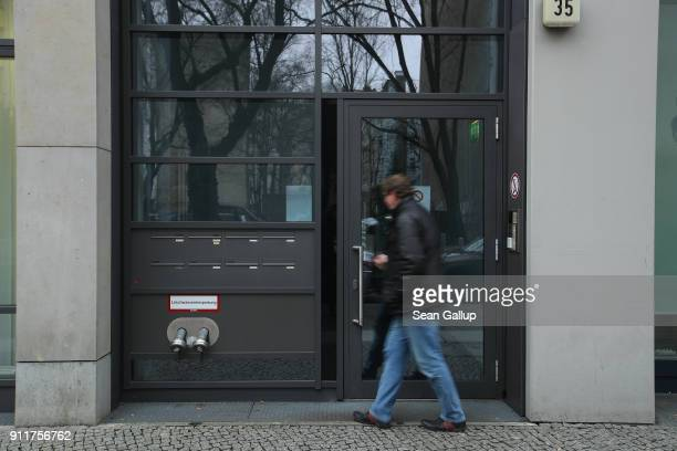 A man enters an office building that includes the office of the European Research Group on Environment and Health in the Transport Sector in...