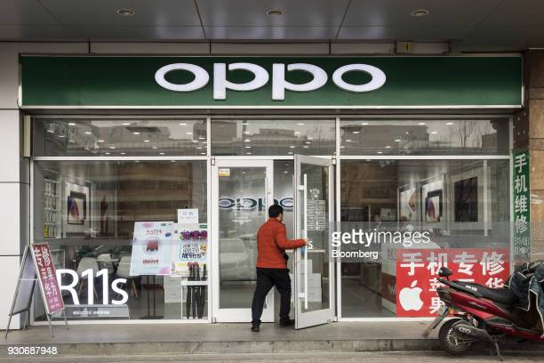 A man enters an Oppo store in Beijing China on Wednesday March 7 2018 China's consumer inflation surged to the fastest in more than four years and...