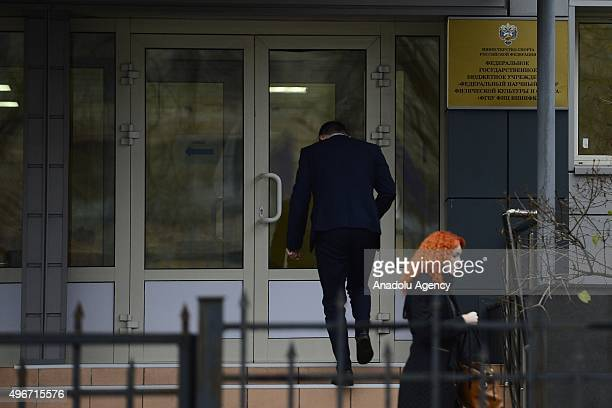 A man enters building of the Federal state budgetary institution 'Federal Scientific Center of Physical Culture and Sport' which houses the Moscow...