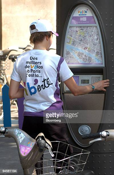 A man enters information into the automated Velib bicyclesharing kiosk on its launch day July 15 in Paris France The 90 millioneuro effort is...
