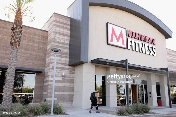 A man enters Mountainside Fitness on June 29 2020 in Glendale Arizona Arizona Gov Doug Ducey ordered all bars gyms theaters water parks and...