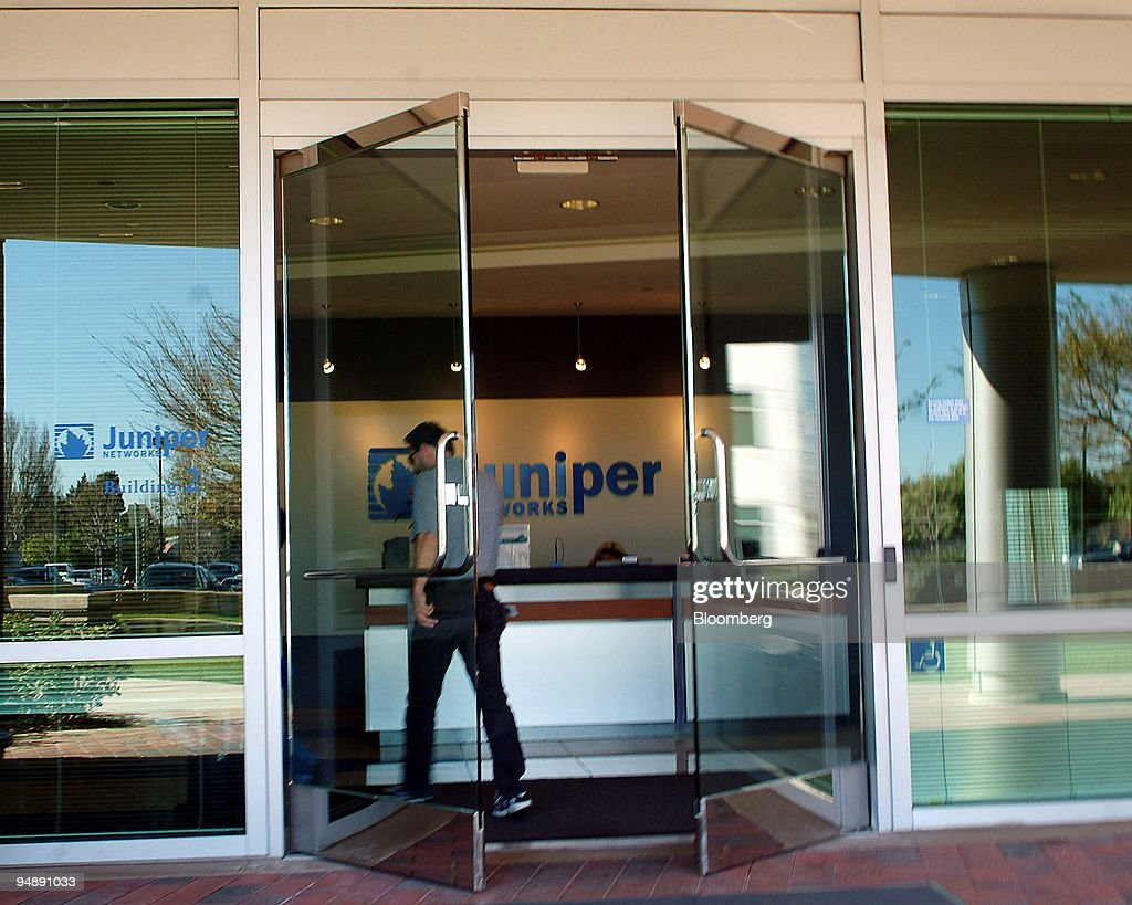 A man enters the headquarters of Juniper Networks in Sunnyvale