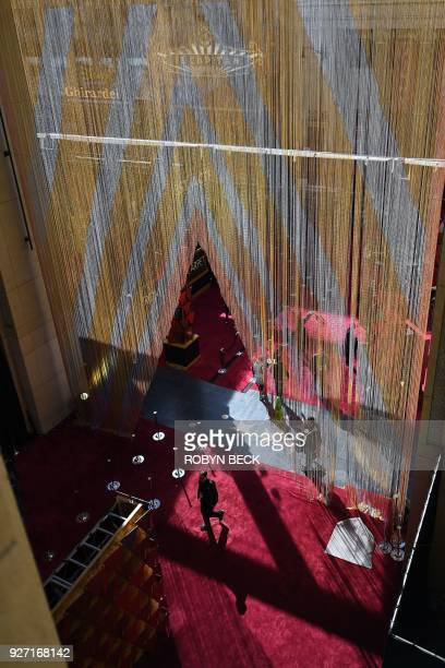 A man enters the red carpet a few hours before the 'Oscars' the 90th Annual Academy Awards on March 4 in Hollywood California / AFP PHOTO / Robyn Beck