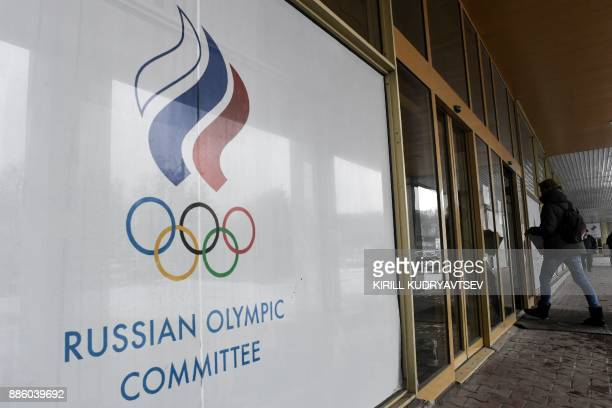 A man enters the Russian Olympic Committee building in Moscow on December 05 2017 The International Olympic Committee meets from Tuesday December 5...