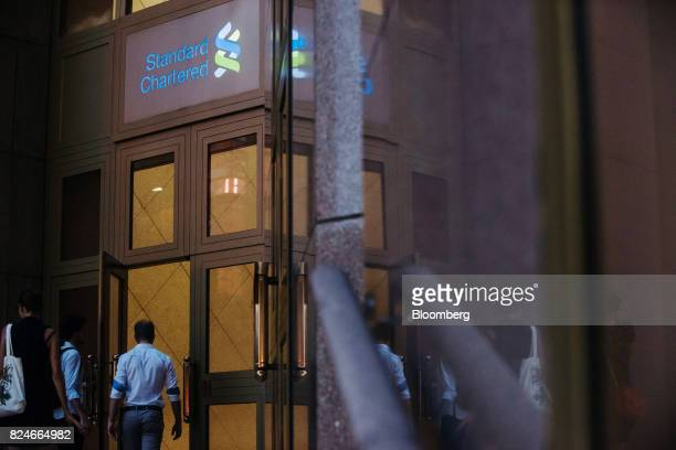 A man enters the Standard Chartered Bank building in Hong Kong China on Sunday July 30 2017 Standard Chartered Plc is scheduled to announce...