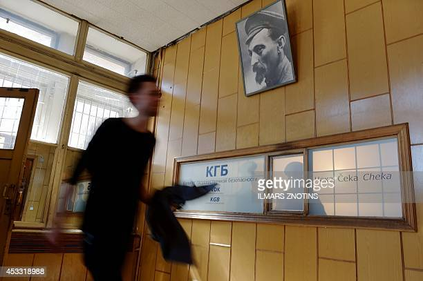 COLLIER A man enters the Stura maja or Corner house the former headquarters of the Soviet KGB in Riga Latvia on July 9 2014 It was one of the most...