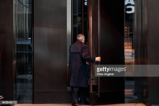 A man enters the Trump SoHo hotel condominium building February 21 2017 in New York City The development of Trump SoHo completed in 2010 was...