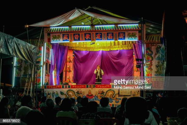 A man entertains Chinese devotees during The Nine Emperor Gods Festival inside the temple on October 23 2017 in Klang Malaysia The Nine Emperor Gods...