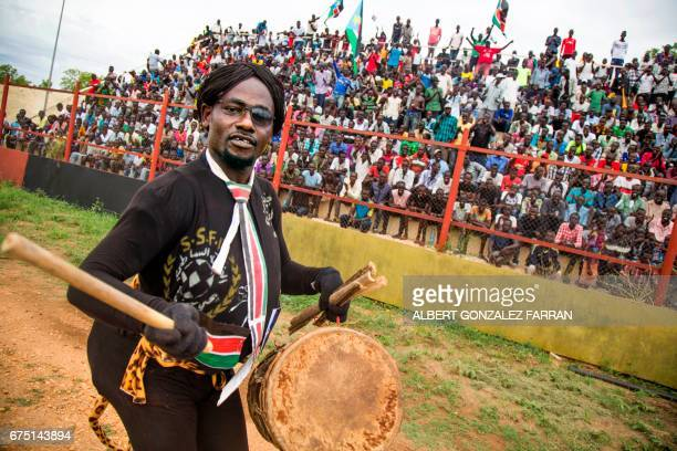 A man entertains South Sudan supporters before the first round African Nations Championship qualifying football match between South Sudan and Somalia...
