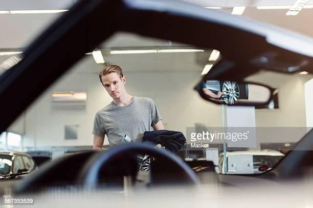 Man examining car in store