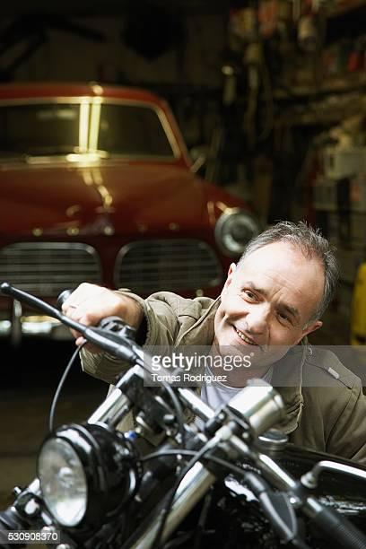 Man examining motorcycle