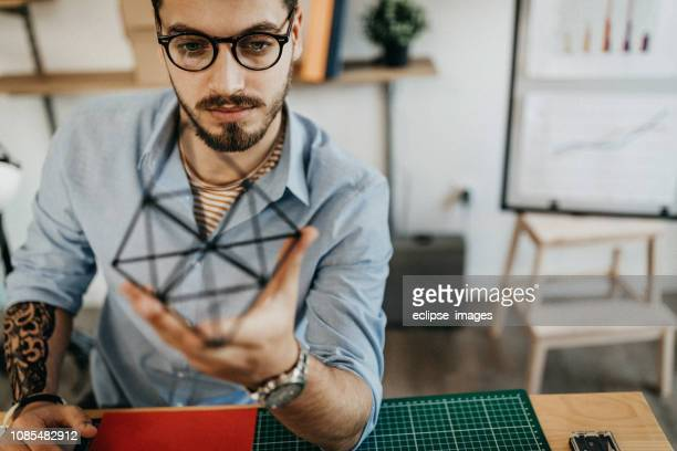 man examining pyramid - pyramid shapes around the house stock pictures, royalty-free photos & images