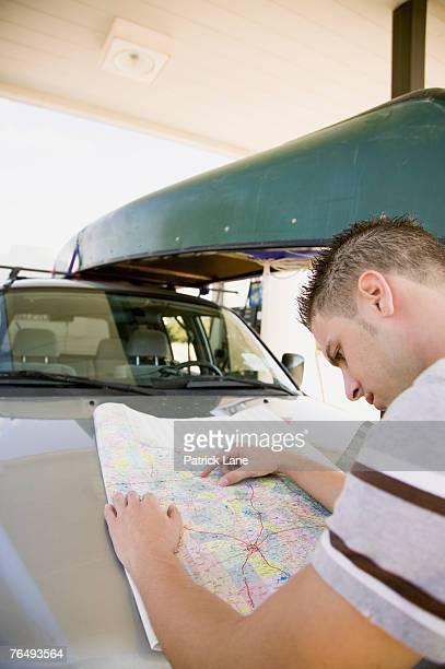 Man examining road map