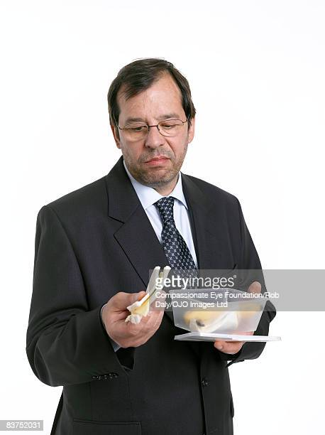 Man Examining Sandwich