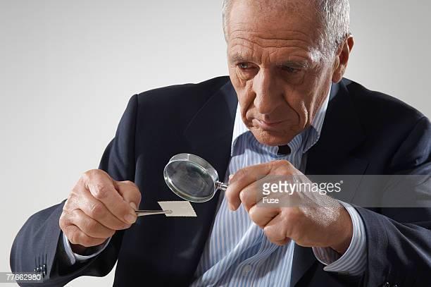 Man Examining Stamp