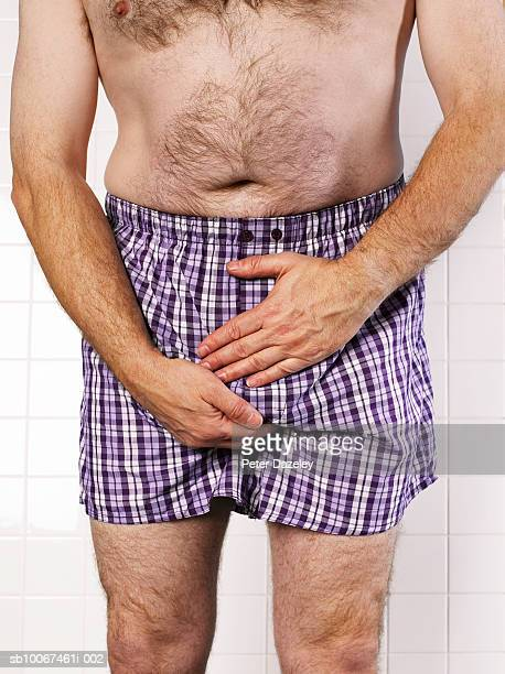 man examining testicles, mid section, close-up - boxershort stock pictures, royalty-free photos & images
