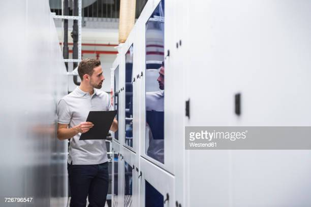 Man examining the system in factory