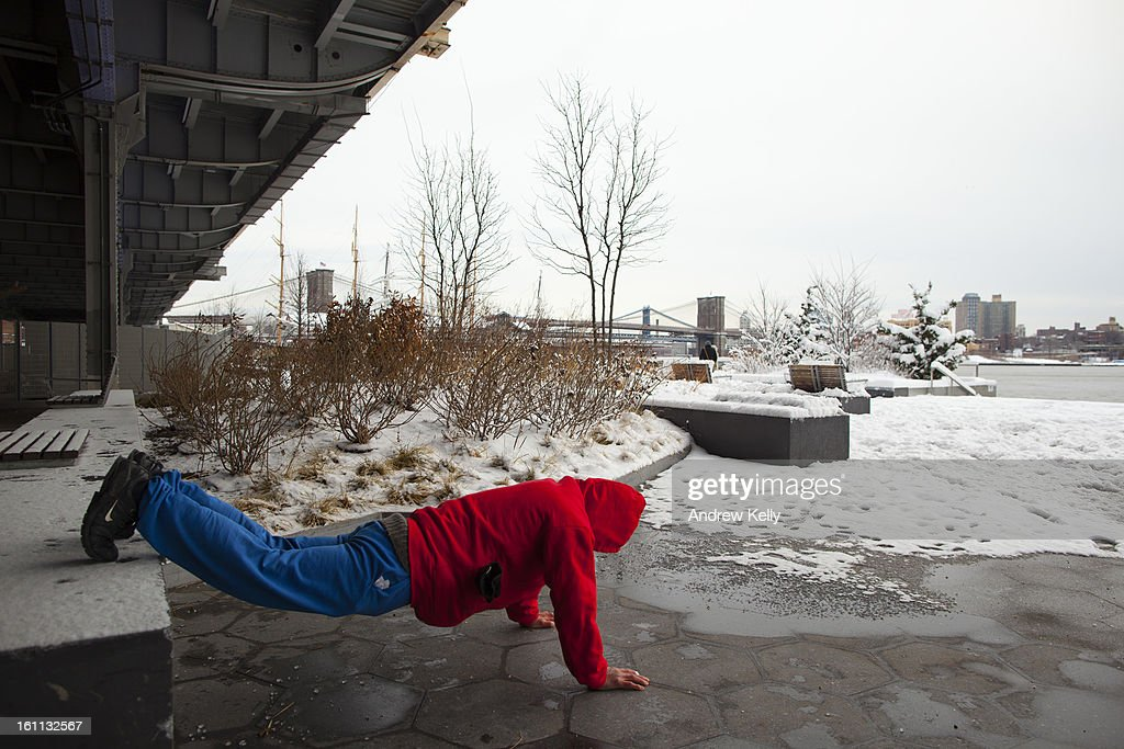 A man excercises along the East River following a major winter storm on February 9, 2013 in New York City. New York City and much of the Northeast received a foot or more of snow through Saturday morning with possible record-setting blizzard conditions expected. Heavy snow warnings are in effect from New Jersey through southern Maine.
