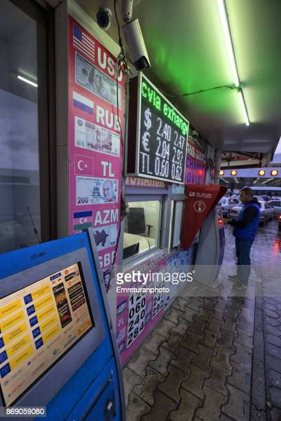 man exchanging currency on an automatic machine at sarp border crossing between turkey and georgia. - emreturanphoto stock pictures, royalty-free photos & images