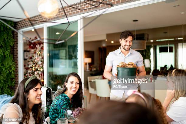 man exchanging presents at charades game at christmas - amigo secreto - só adultos imagens e fotografias de stock