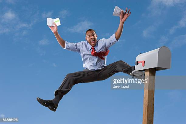 man excited in front of mail box - legs spread open stock photos and pictures