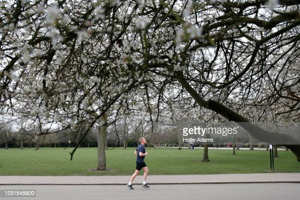 Man exercises at Victoria Park on March 6, 2021 in London, England. The UK Government recently announced the roadmap out of England's third...