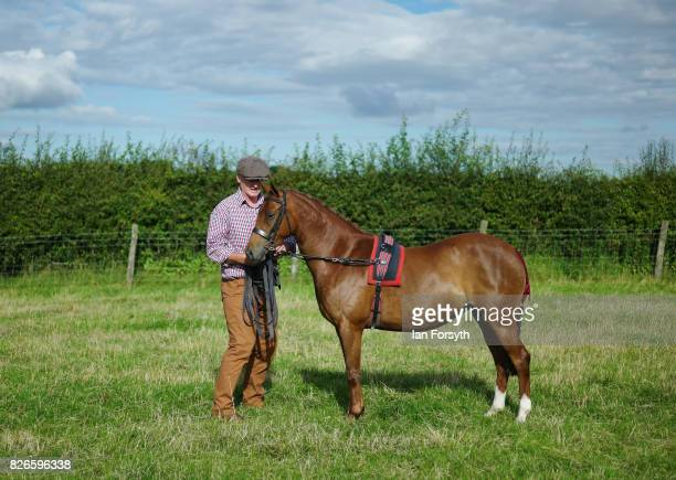 Man exercises his horse during the Osmotherley Country Show on August 5, 2017 in Osmotherley, England. The annual show hosts pony, cattle and sheep...