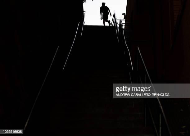 A man exercises on the stairs made famous by the 1973 movie The Exorcist in Georgetown in Washington DC on October 29 2018 The 75 steps served as the...