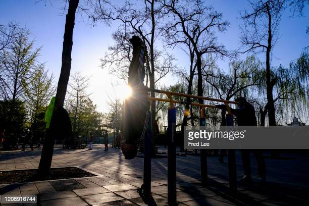 A man exercises while wearing a mask as part of precautionary measures against the spread of the COVID19 on April 02 2020 in Beijing China Health...