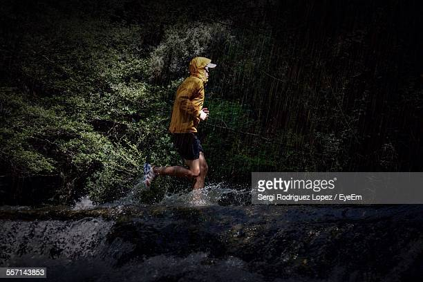 man exercising in forest - cross country running stock pictures, royalty-free photos & images