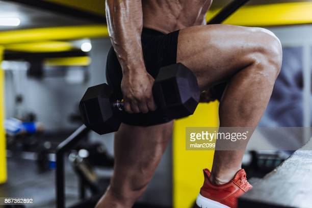 man exercising in the gym - calf stock pictures, royalty-free photos & images