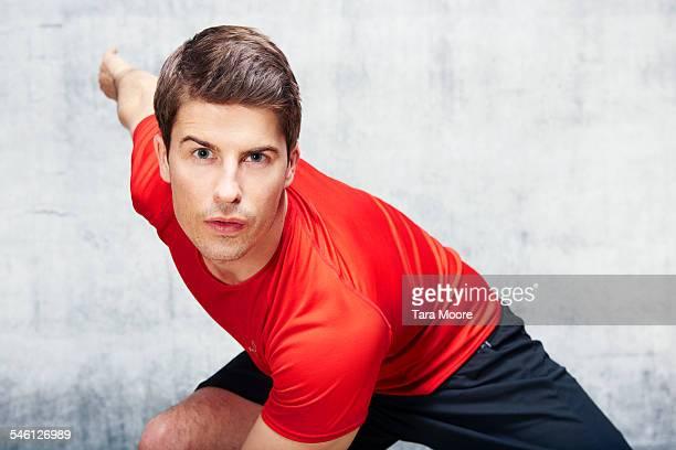 Man exercising in urban studio setting