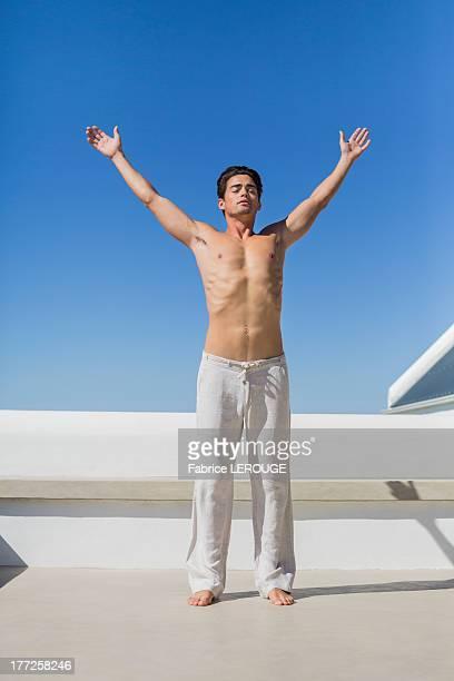 man exercising - セミヌード ストックフォトと画像