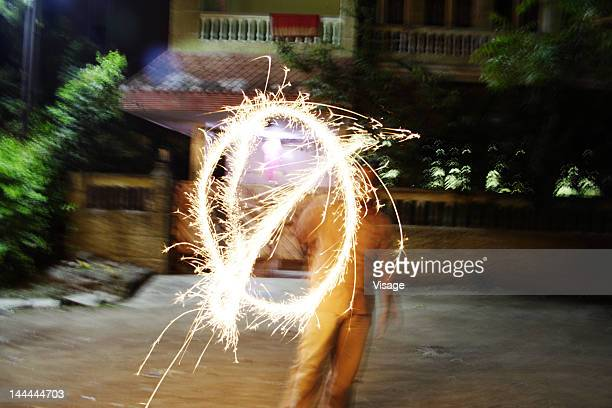 A man exhibiting fireworks
