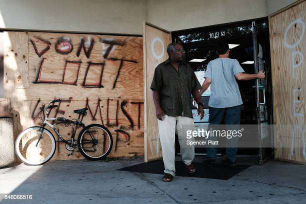 A man exits a 7Eleven one of the few stores open two days after Hurricane Irma swept through the area on September 12 2017 in Cape Coral Florida...
